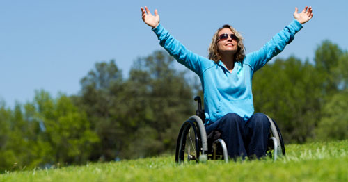 woman in wheelchair on a hill